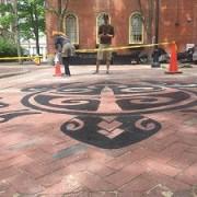Salem Pedestrian Brick Walk Getting a Tattoo